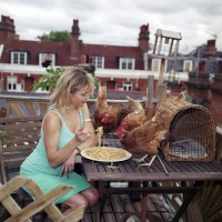 24. Re-Home Series. Julia Stephenson with her rooftop hens.